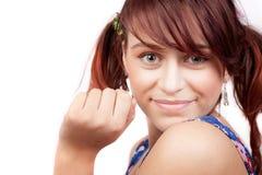 逗人喜爱的嬉戏的微笑青少年的妇女 免版税库存照片