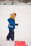 逗人喜爱的孩子,男孩,滑与在雪的突然移动,冬天 库存图片