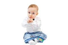 逗人喜爱的害羞的孩子 免版税库存照片