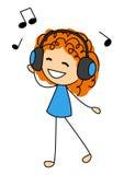 逗人喜爱的小女孩听的音乐 免版税图库摄影