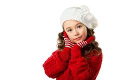 逗人喜爱的小女孩在冬天在被隔绝的白色背景穿衣 库存图片