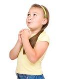 逗人喜爱的小女孩祈祷 免版税库存图片