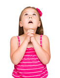 逗人喜爱的小女孩祈祷 免版税库存照片