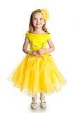 逗人喜爱的小女孩纵向公主礼服的 免版税库存图片