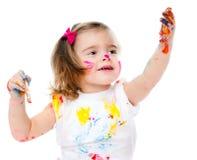 逗人喜爱的小女孩绘画 免版税图库摄影