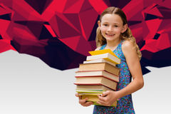逗人喜爱的小女孩运载的书的综合图象在图书馆里 库存照片