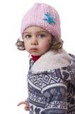 被隔绝的女孩。 穿戴为冷的温度。 免版税库存图片