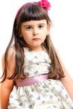 逗人喜爱的小女孩画象被隔绝的公主礼服的。 免版税库存照片