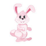 逗人喜爱的微笑的桃红色复活节兔子 免版税库存照片