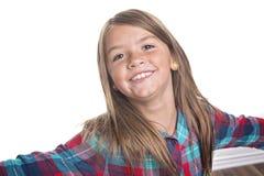 逗人喜爱的快乐的小女孩画象,隔绝在灰色背景 免版税库存照片