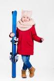 逗人喜爱的愉快的男孩画象在手上的拿着滑雪 库存照片