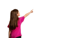 逗人喜爱的手指女孩指向的一点 免版税库存图片