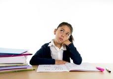 逗人喜爱的拉丁学校孩子乏味在与一个疲乏的面孔表示的重音下 免版税库存照片