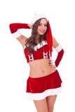 逗人喜爱的摆在的圣诞老人妇女年轻&# 库存图片