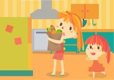 逗人喜爱的母亲和她的孩子在厨房里 皇族释放例证
