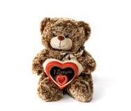 逗人喜爱的玩具熊和红色巧克力心脏与文本 免版税库存照片