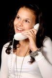 逗人喜爱的电话联系的妇女年轻人 库存照片