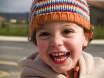 逗人喜爱的男孩微笑的一点 图库摄影