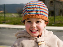 逗人喜爱的男孩微笑的一点 库存图片