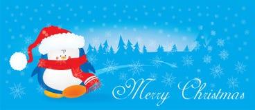 逗人喜爱的看的圣诞节企鹅 免版税库存照片