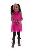 逗人喜爱的矮小的非裔美国人的女孩微笑的-黑人-孩子 图库摄影