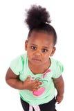逗人喜爱的矮小的非裔美国人的女孩 免版税库存照片