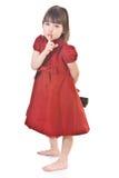 逗人喜爱的礼服女孩红色的一点 免版税库存图片