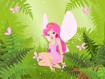 逗人喜爱的神仙到不可思议的森林里 免版税库存图片