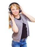 逗人喜爱的耳机少年 免版税库存照片