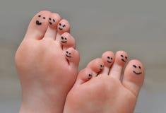 逗人喜爱的脚趾 免版税库存照片