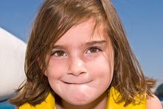 逗人喜爱的表达式女孩 库存图片