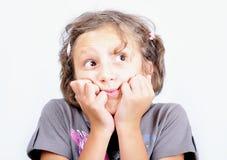 逗人喜爱的表达式表面女孩奇怪的一&# 免版税库存照片