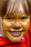 逗人喜爱的表面女孩被绘 免版税库存照片