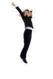 逗人喜爱的跳的女小学生 免版税库存图片