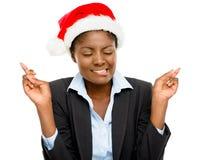 逗人喜爱的非裔美国人的女实业家手指横渡的佩带的Chri 免版税图库摄影