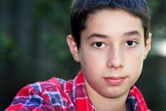 逗人喜爱的黑眼睛的非离子活性剂男孩 图库摄影