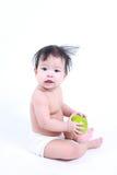 逗人喜爱的婴孩用绿色苹果 库存图片