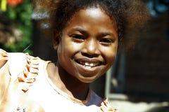 逗人喜爱的年轻非洲黑人女孩-可怜的孩子 免版税库存照片