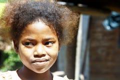 逗人喜爱的年轻非洲黑人女孩-可怜的孩子 免版税库存图片