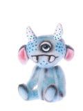 逗人喜爱被充塞的一个注视动物蓝色妖怪玩具 库存图片