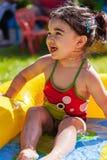 逗人喜爱,愉快,微笑的小孩女婴,使用在五颜六色可膨胀 库存图片