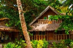 通常地方农村房子在Apo海岛,菲律宾 库存照片