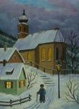 通往教会的道路在与光的冬天在窗口里 免版税图库摄影