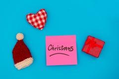 通知关于圣诞节的桃红色贴纸 免版税库存图片
