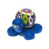 通过使用在白色隔绝的膏药的乌龟雕象 免版税图库摄影