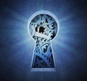 通过匙孔被看见的嵌齿轮轮子 免版税库存图片