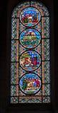 通过被弄脏的阳光视窗视窗的教会玻璃 免版税库存照片