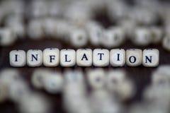 通货膨胀-与木立方体的修造 免版税图库摄影
