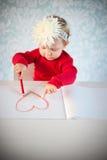 速写心脏的逗人喜爱的liitle女孩 库存图片
