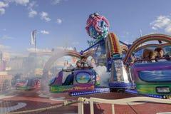 速度和蒸气在转动octopussy陀螺在慕尼黑啤酒节, 免版税库存照片